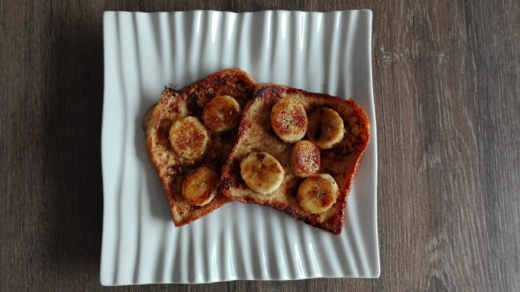 French toast with cinnamon and baked banana